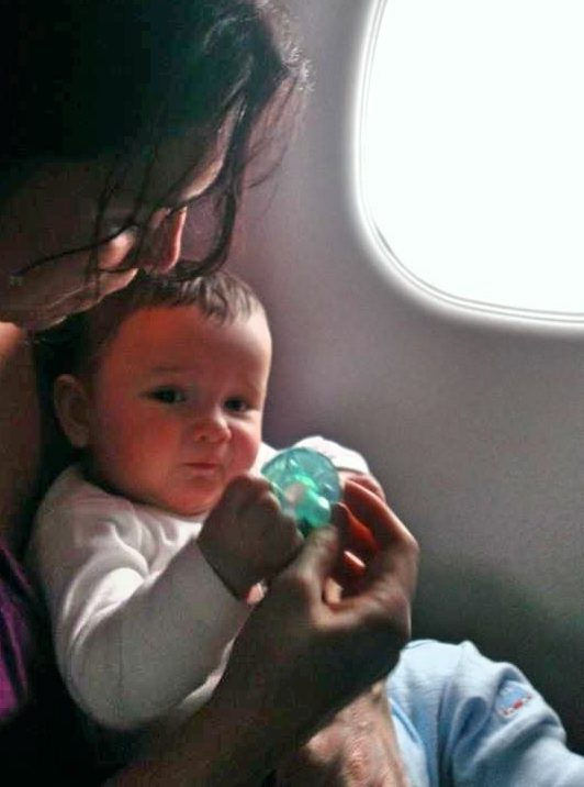 baby's first airplane ride travel with baby essential guide